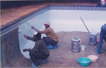 workers applying a new fibreglass lining to a pool