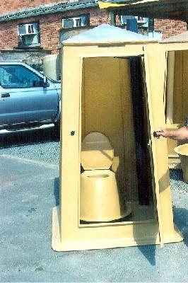 Portable toilet with door open